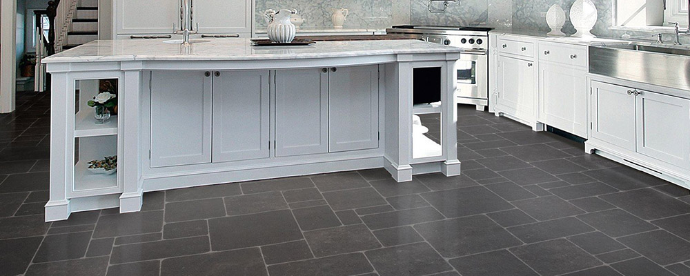 Dark flooring with beautiful white cabinets and island