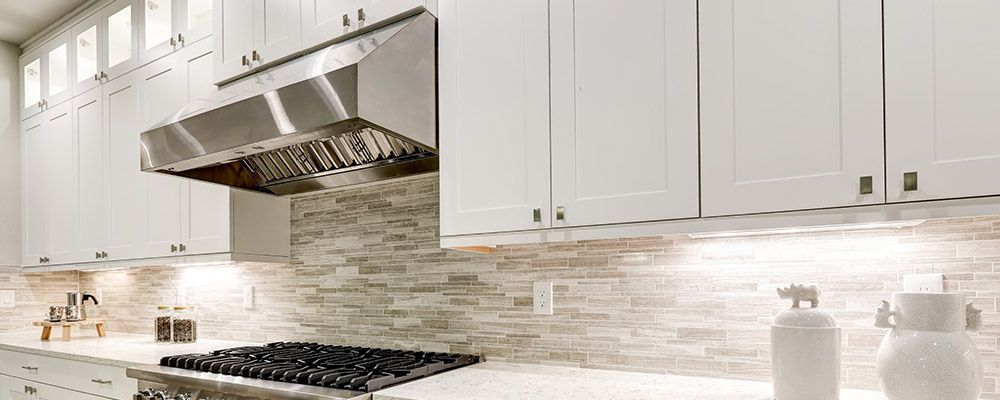 White kitchen cabinets. stainless steel stove.