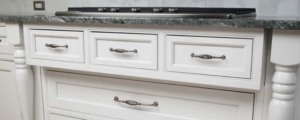 White kitchen drawer. Under stove. Silver hardward