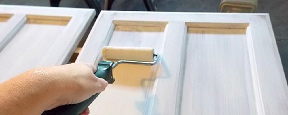 Roller brush. Painting a white cabinet