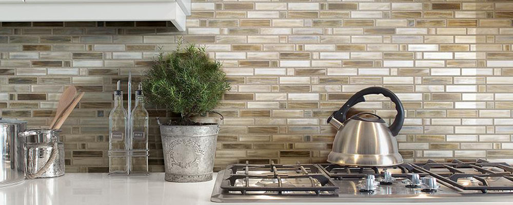 Beige tile kitchen backsplash.