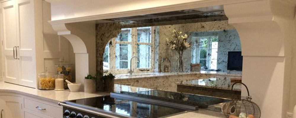 Mirror backsplash. Kitchen