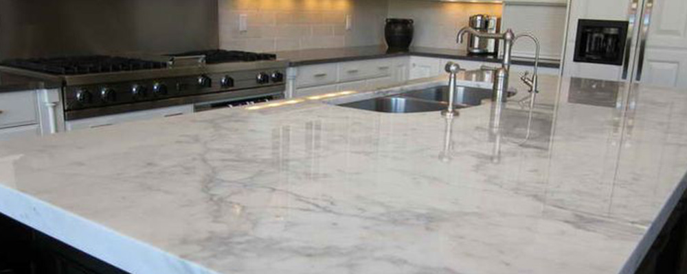 Quartz countertop. white and grey island.