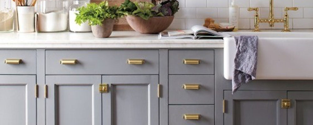grey kitchen with gold hardware