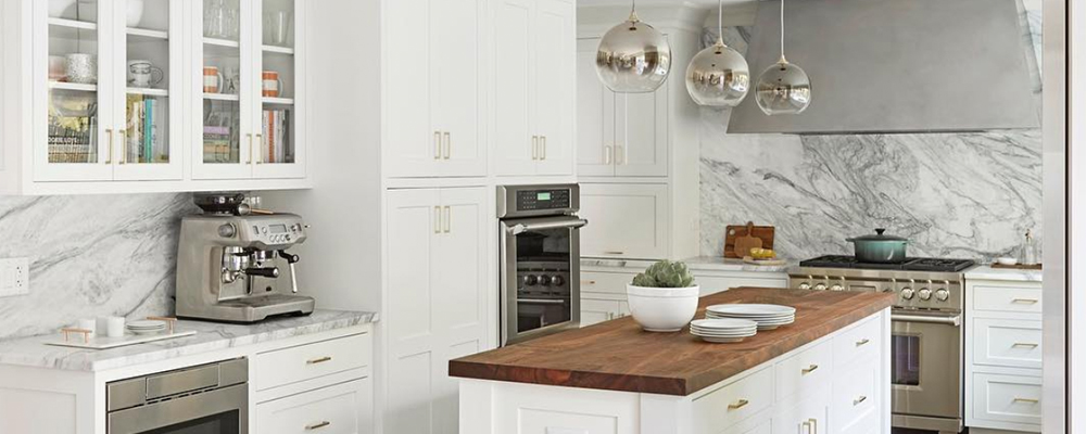 white kitchen with block countertop