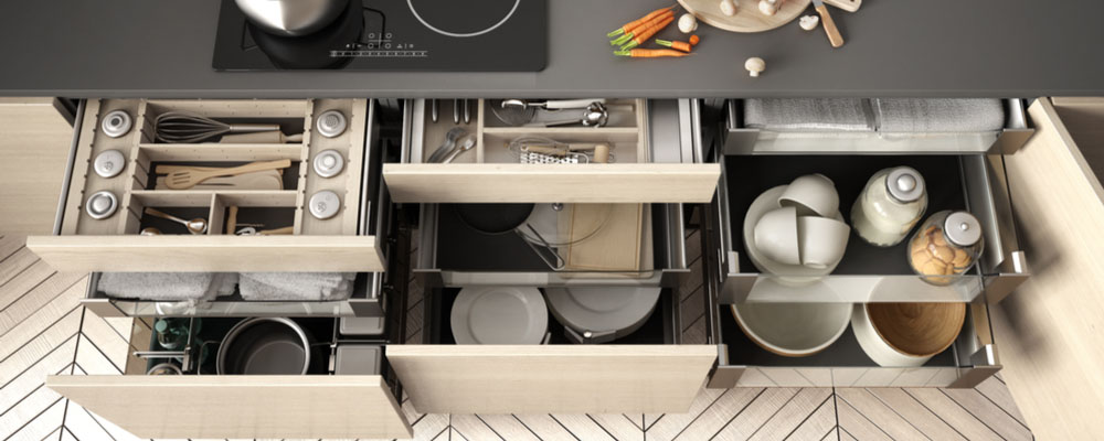 A photo of an organized kitchen drawer with pots and pans. Kitchen Organizational Tips