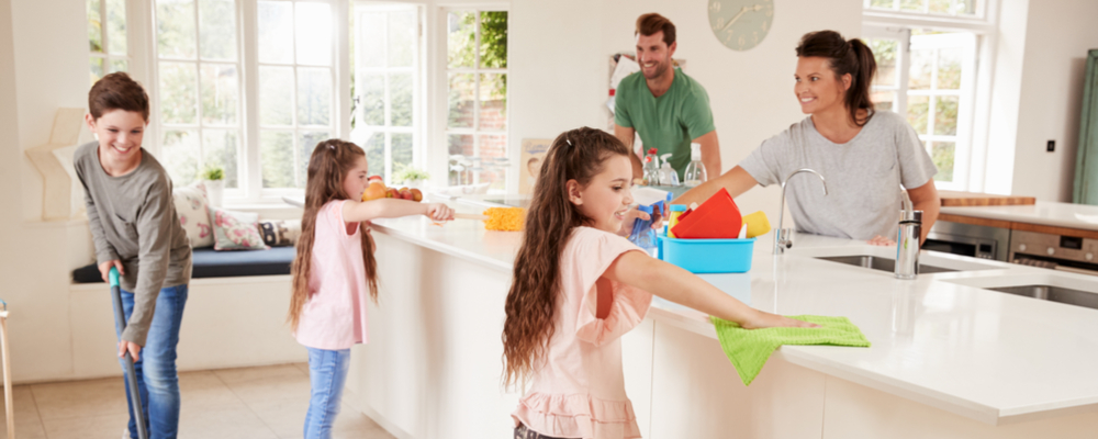 A photo of a family working together on cleaning the kitchen. Kitchen Organizational Tips